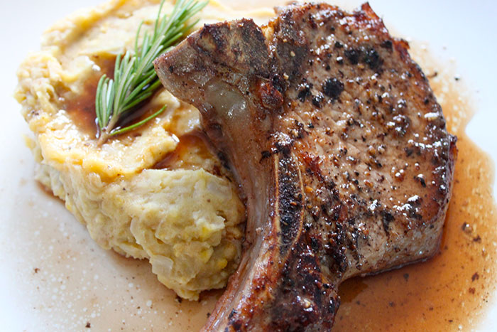 Roasted Pork Chops Pomegranate Pizzazz ® over Mashed Plantains